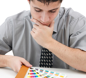 Man deciding whether to use RGB vs CMYK vs PMS color